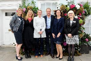 Pictured is: (l-r) Sarah Woods, corporate fundraiser. Emma Schwarz, founder of The Rare Brand Market, Susie Babington, florist, actor Hugh Bonneville, Marian Parfitt, Breast Cancer Haven centre manage and Sally Hillyear, fundraising manager.''Picture: Sarah Standing (180726-5301)
