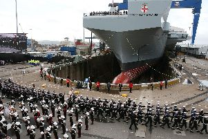 The Royal Marines band and members of the Royal Navy during the naming ceremony of aircraft carrier HMS Prince of Wales at the Royal Dockyard in Rosyth in 2017 Picture: Andrew Milligan/PA Wire