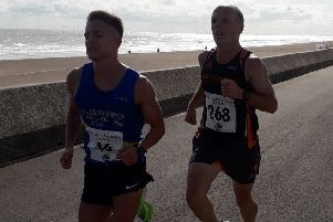 Jordan Carlisle (left) and Mark Sands matched each other stride for stride right to the finish EMN-191209-132234002