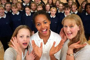 The three soloists lead the Mayfield School Gospel Choir (left to right), Lucy Mitchell (15), Gemma Anderson (14), and Kerry Kenward (14) in October 1999