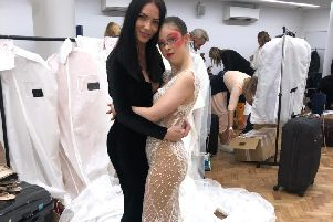 April Banbury pictured with one of her models at London Fashion Week