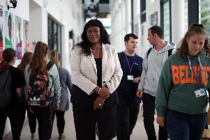 Stella Mbubaegbu, principal of Highbury College, pictured in June 2018 at the college in Cosham with students. Picture: Chris Moorhouse