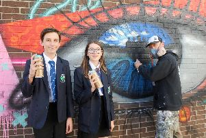Oscar Williams, 14, Amy Holden, 14, and artist My Dog Sighs.'Picture: Sarah Standing