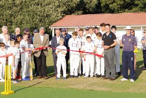 The ribbon being cut on the new non-turf pitch.