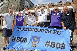 Members of the Pompey supporters group - #808 have raised funds for the Portsmouth Association for the Blind.'From left, Paul Turnbull, Kevin Ryan, Ian Howard-Harwood and Phillip Dolley of the Association, with Helen Chivers and Graham Price.''Picture: Ian Hargreaves  (270819-1)