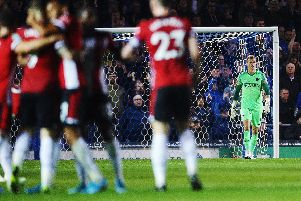 Pompey keeper Craig MacGillivray looks disappointed after Danny Ings' second goal    Picture: Joe Pepler