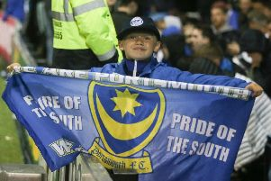 Young Pompey fan with 'Pride of the South' flag at Fratton Park last night