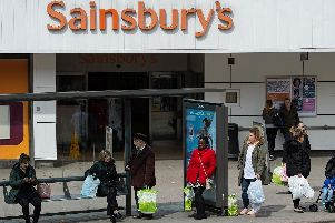 Sainsbury's has announced plans to close supermarkets and Argos stores (Picture OLI SCARFF/AFP/Getty Images)