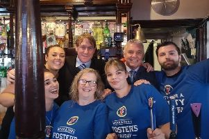 Portsmouth FC director Eric Eisner with staff at the Milton Arms in Portsmouth, where he enjoyed a pint of beer ahead of the Pompey v Southampton match
