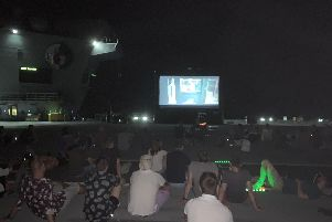 HMS Queen Elizabeth's crew enjoy a movie night of mega proportions as they enjoy a well-earned evening off on Thursday, Seoptember 26. The screening of The Greatest Showman came as the aircraft carrier continued its Westlant 19 deployment off the east coast of the USA. Picture: HMS Queen Elizabeth