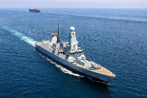 Type 45 Destroyer HMS Duncan escorts the container ship Brighton throughthe  international shipping lanes in the Gulf. Picture: Rory Arnold / Royal Navy