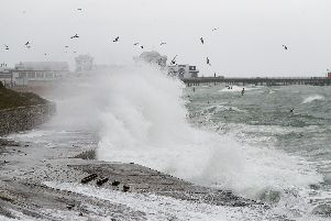 Waves crashing on the seafront near to the South Parade pier in Southsea. Picture: Andrew Matthews/PA Wire