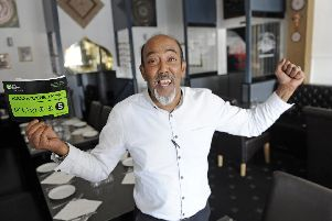 Babul Miah celebrates after earning his first ever five star hygiene rating at his restaurant, the Bombay Express Bali in Southsea.''Picture: Ian Hargreaves  (010919-1)