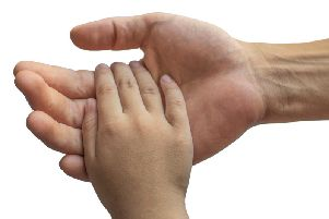 A man holding a child's hand