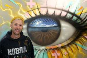 International artist My Dog Sighs painted a mural at the Village Hotel in North Harbour, Portsmouth as part of the hotel's Village Green campaign. Picture: Annabelle Dryden-Smith