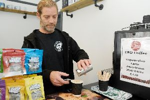 Activist group Hampshire Canna has opened a CBD shop in London Road, Hilsea selling smoking supplies as well as cannabis oil products.''Pictured is: Owner Sy Dignam making a CBD coffee.''Picture: Sarah Standing (071019-8430)