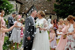 Charlotte and Andy Moody outside St Peter's Church, Hayling Island. Picture: Mark Robbins Photography