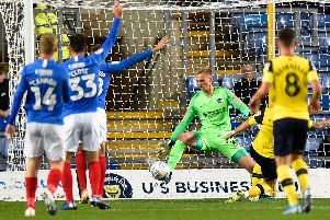 Alex Bass pulls off yet another superb stop during a man-of-the-match performances in last night's Leasing.com Trophy fixture at Oxford United. Picture: Graham Hunt/ProSportsImages