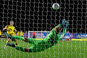 Alex Bass superbly saves from Josh Ruffels during an impressive night against Oxford United for the young keeper. Picture: Graham Hunt/ProSportsImages