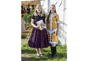 Daisy-May Smith at the Goodwood Revival with her winning 1960s-style design that was made into a dress by Goodwood's wardrobe department and worn by a model at the event    Picture: Steven Stringer