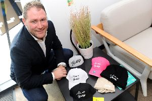 Lee Bradbury with some of his hats from his new clothing brand Bridge.''Picture: Sarah Standing (101019-8581)
