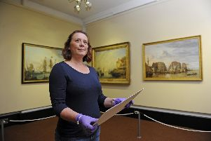 A new exhibition showing art work depicting Portsmouths historical naval history has been opened at Portsmouth Museum. Curator Susan Ward makes her final checks.''Picture: Ian Hargreaves  (010919-1)