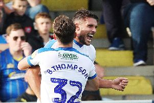 Gareth Evans and Ben Thompson celebrate then-League One leaders Pompey scoring at AFC Wimbledon 12 months ago. Picture: Joe Pepler/Digital South