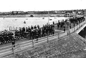 The gun carriage bearing Admiral Frasers coffin passes over the bridge to enter HMS Excellent, Whale Island, in 1981. Picture: Mike Smith collection/The News archive.