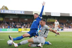 Lee Brown in action against AFC Wimbledon. Picture: Joe Pepler