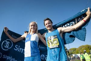 Eilish McColgan, left, and Chris Thompson celebrate their Great South Run 2018 victories. Picture: Peter Langdown
