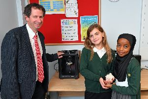 (left to right) Chris Heal of EMCO Education with Eva Osborne (10) and Mesbah Hussein (10) with their 3D Printer prototype, 'Meva'