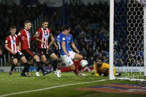 John Marquis pokes Pompey in front against Lincoln. Picture: Joe Pepler