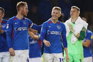 Ross McCrorie, centre, celebrates Pompey's win. Picture: Joe Pepler