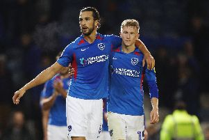 Christian Burgess and Ross McCrorie look pleased after Pompey's win against Lincoln