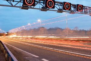 Smart motorways see overhead gantries install temporary speed limits.
