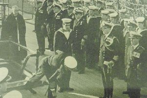 Commander-in-Chief, Naval Home Command Admiral Sir Horace Law lays the wreath on HMS Victory.