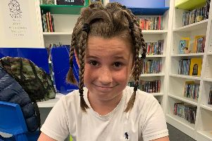 Kian Thomas, 11, had grown his hair for three years before deciding to have it cut off for charity.