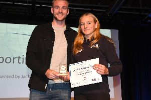 Jack Whatmough presents the Sporting Achievement Award to Jessica Adopho-Pugh.