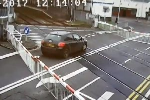 Driver ignoring warnings at a level crossing