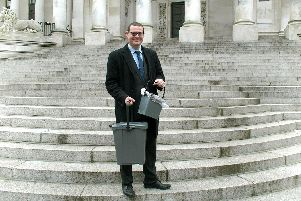 Cllr Dave Ashmore outside the Guildhall with the new food waste caddies