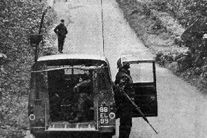 Hampshire Gunners double back to their patrol vehicles after checking for explosives beneath a bridge.