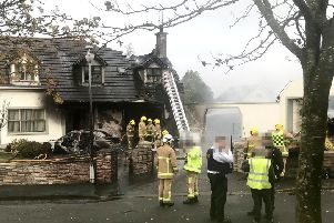 The house and garage and a Mercedes car were destroyed in the fire. Pic Steven McAuley/McAuley Multimedia