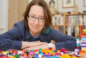 Abbie Headon from Southsea, has written a book about playing with Lego as an adult as a mindfulness activity and to bring more happiness into people's lives. 'Picture: Sarah Standing (081119-1353)