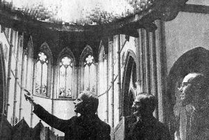 The Rev David Mahy, left, conducts the Cardinal on a tour of Portsmouth RC Cathedral. Bishop Worlock is on the right.