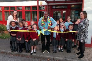 Dave Benson Phillips cuts the ribbon to officially open Heene Primary School as a certified Makaton Friendly provider, with teacher Sarah Chandler, left, head teacher Jo MacGovern and signing ambassadors