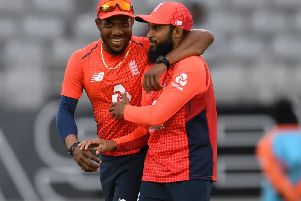 Chris Jordan and Adil Rashid celebrate England's dramatic success in Auckland / Picture: Getty Images