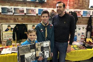From left, Ben, Joshua and Wesley Taylor, with Wesley's dad Colin in the Waterlooville Scouts scrapbook, circa 1966. Picture: David George
