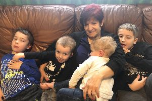 Gosport nan Kaz Clark has written a booklet called The Nanny Duties, full of stories of looking after four of her grandsons to raise funds for the neonatal intensive care unit at Queen Alexandra Hospital. Pictured here with Jake Hollis, eight, Daniel Hollis, seven, Benjamin Hollis, two and Michael Hollis, one.