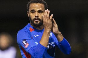Anton Walkes applauds the Pompey fans following a rare first-team outing on Monday night. Picture: Daniel Chesterton/PinPep
