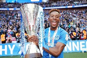 Jamal Lowe with the EFL Trophy last season following a penalty shootout victory against Sunderland   Picture: Joe Pepler